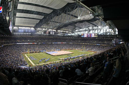 The U.S. flag is unfurled during the national anthem before the first quarter of an NFL football game between the Detroit Lions and the Houston Texans at Ford Field in Detroit, Thursday, Nov. 22, 2012. &#40;AP Photo&#47;Carlos Osorio&#41; <span class=meta>(AP Photo&#47; Carlos Osorio)</span>