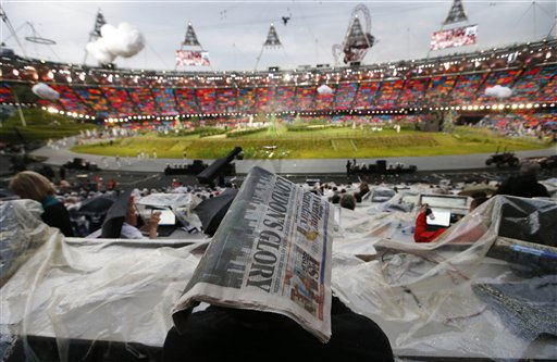 A member of the media covers himself with a newspaper during a rain shower ahead of the Opening Ceremony at the 2012 Summer Olympics, Friday, July 27, 2012, in London.   <span class=meta>(AP Photo&#47; Jae C. Hong)</span>