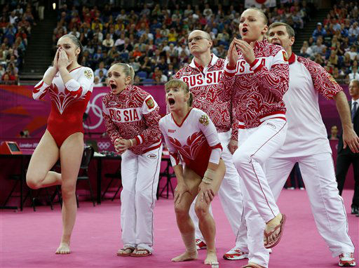 Russian gymnasts and team officials react as teammate Kseniia Afanaseva falls while performing on the floor during the Artistic Gymnastics women&#39;s team final at the 2012 Summer Olympics, Tuesday, July 31, 2012, in London. &#40;AP Photo&#47;Matt Dunham&#41; <span class=meta>(AP Photo&#47; Matt Dunham)</span>