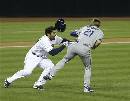 San Diego Padres&#39; Carlos Quentin charges into Los Angeles Dodgers  pitcher Zack Greinke after being hit by a pitch in the sixth inning of baseball game in San Diego, Thursday, April 11, 2013.   <span class=meta>(AP Photo&#47; Lenny Ignelzi)</span>
