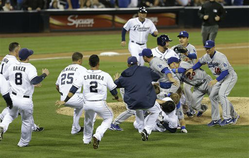 "<div class=""meta ""><span class=""caption-text "">San Diego Padres' Carlos Quentin and teammates battle the Los Angeles Dodgers after Quentin was hit by a pitch thrown by Dodgers pitcher Zack Greinke in the sixth inning of baseball game in San Diego, Thursday, April 11, 2013.  (AP Photo/ Lenny Ignelzi)</span></div>"