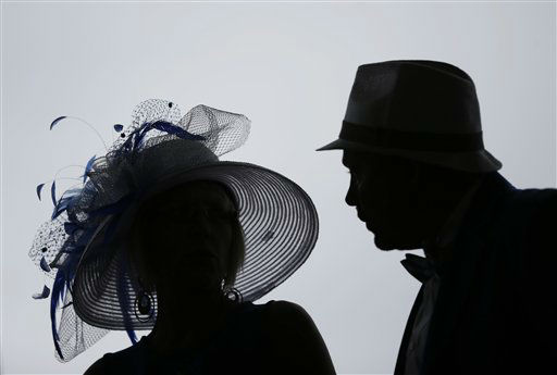 Spectators arrive with fancy hats to attend the 139th Kentucky Derby at Churchill Downs Saturday, May 4, 2013, in Louisville, Ky.   <span class=meta>(AP Photo&#47; Matt Slocum)</span>
