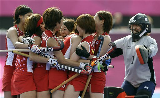 Japan&#39;s players celebrate winning their classification hockey match against South Africa at the Riverside Arena at the 2012 Summer Olympics, London, Wednesday, Aug. 8, 2012. &#40;AP Photo&#47;Kirsty Wigglesworth&#41; <span class=meta>(AP Photo&#47; Kirsty Wigglesworth)</span>