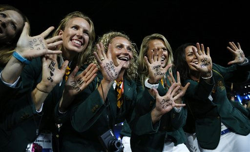 Australian athletes with messages on their hands pose for photographers during the Opening Ceremony at the 2012 Summer Olympics, Friday, July 27, 2012, in London.   <span class=meta>(AP Photo&#47; Matt Dunham)</span>