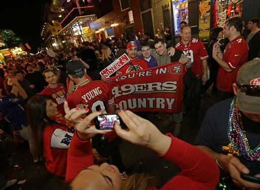 "<div class=""meta ""><span class=""caption-text "">San Francisco 49ers fans pose as they walk along Bourbon Street in the French Quarter Saturday, Feb. 2, 2013, in New Orleans. The Baltimore Ravens will face the San Francisco 49ers in NFL football's Super Bowl XLVII on Sunday. (AP Photo/Dave Martin) (AP Photo/ Dave Martin)</span></div>"