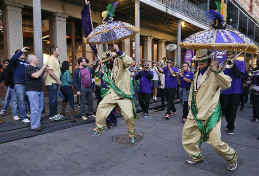 A jazz band marches through the French Quarter near Jackson Square as football fans watch, Saturday, Feb. 2, 2013, in New Orleans. The city will host NFL football&#39;s Super Bowl XLVII between the Baltimore Ravens and the San Francisco 49ers on Sunday. &#40;AP Photo&#47;Julie Jacobson&#41; <span class=meta>(AP Photo&#47; Julie Jacobson)</span>
