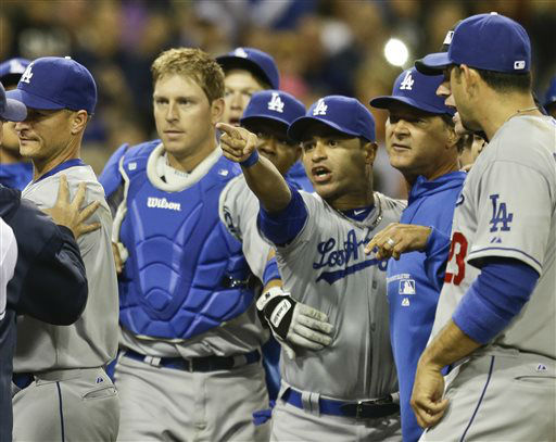 "<div class=""meta ""><span class=""caption-text "">Los Angeles Dodgers' Jerry Hairston Jr. points at someone on the San Diego Padres as he is restrained by A.J. Ellis  after a braw that had subsided started up again during the sixth inning of baseball game in San Diego, Thursday, April 11, 2013.   (AP Photo/ Lenny Ignelzi)</span></div>"