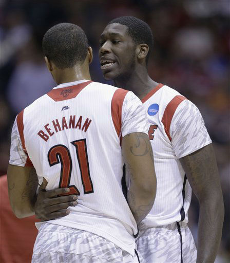 Louisville&#39;s Montrezl Harrell talks to teammate Chane Behanan &#40;21&#41; after Louisville guard Kevin Ware was injured during the first half of the Midwest Regional final against Duke in the NCAA college basketball tournament, Sunday, March 31, 2013, in Indianapolis. Louisville won 85-63 to advance to the Final Four.  <span class=meta>(AP Photo&#47; Darron Cummings)</span>