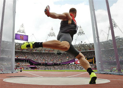 Germany&#39;s Robert Harting takes a throw in a men&#39;s discus throw qualification round during the athletics in the Olympic Stadium at the 2012 Summer Olympics, London, Monday, Aug. 6, 2012. &#40;AP Photo&#47;Matt Dunham&#41; <span class=meta>(AP Photo&#47; Matt Dunham)</span>