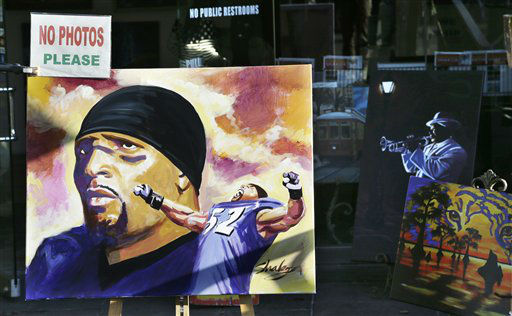 A painting of Baltimore Raven&#39;s Ray Lewis is displayed on a sidewalk in the French Quarter Saturday, Feb. 2, 2013, in New Orleans. The city will host NFL football&#39;s Super Bowl XLVII between the Baltimore Ravens and the San Francisco 49ers on Sunday &#40;AP Photo&#47;Elaine Thompson&#41; <span class=meta>(AP Photo&#47; Elaine Thompson)</span>