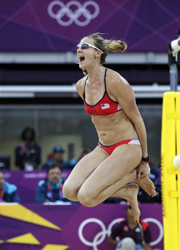 Kerri Walsh Jennings of the United States leaps in the air after beating China in two sets during a women&#39;s semi-final beach volleyball match at the 2012 Summer Olympics, Tuesday, Aug. 7, 2012, in London. &#40;AP Photo&#47;Dave Martin&#41; <span class=meta>(AP Photo&#47; Dave Martin)</span>