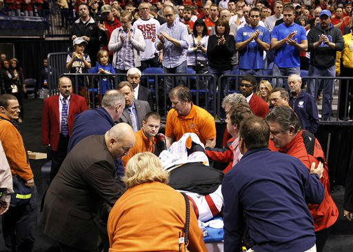 "<div class=""meta image-caption""><div class=""origin-logo origin-image ""><span></span></div><span class=""caption-text"">Louisville guard Kevin Ware is taken off the court on a stretcher after badly injuring his lower right leg during the first half of the Midwest Regional final against Duke in the NCAA college basketball tournament, Sunday, March 31, 2013, in Indianapolis.  (AP Photo/ Darron Cummings)</span></div>"
