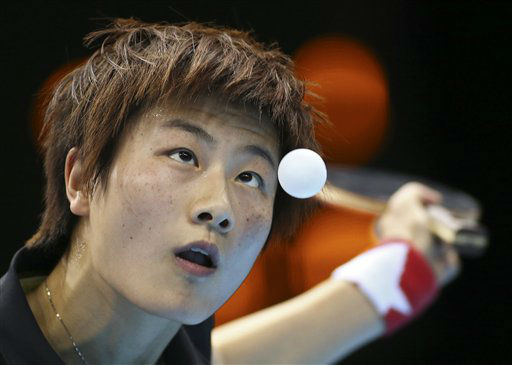 China&#39;s Ding Ning serves against Japan&#39;s Kasumi Ishikawa in a women&#39;s team table tennis gold medal match at the 2012 Summer Olympics, Tuesday, Aug. 7, 2012, in London. &#40;AP Photo&#47;Sergei Grits&#41; <span class=meta>(AP Photo&#47; Sergei Grits)</span>