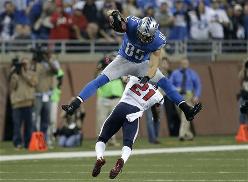 Detroit Lions tight end Tony Scheffler &#40;85&#41; jumps over Houston Texans defensive back Brice McCain &#40;21&#41; during overtime of an NFL football game at Ford Field in Detroit, Thursday, Nov. 22, 2012.  <span class=meta>(AP Photo&#47; Paul Sancya)</span>