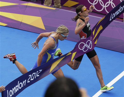 Switzerland&#39;s Nicola Spirig, right, finishes ahead of Sweden&#39;s Lisa Norden to win the gold medal in the women&#39;s triathlon at the 2012 Summer Olympics, Saturday, Aug. 4, 2012, in London. Norden took the silver. &#40;AP Photo&#47;Charlie Riedel&#41; <span class=meta>(AP Photo&#47; Charlie Riedel)</span>
