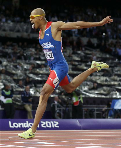 Dominican Republic&#39;s Felix Sanchez crosses the finish line to win the men&#39;s 400-meter hurdles final during the athletics in the Olympic Stadium at the 2012 Summer Olympics, London, Monday, Aug. 6, 2012. &#40;AP Photo&#47;David J. Phillip&#41; <span class=meta>(AP Photo&#47; David J. Phillip)</span>