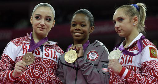 U.S. gymnast and gold medallist Gabrielle Douglas, center, Russian gymnast and silver medallist Victoria Komova, right, and Russian gymnast and bronze medallist Aliya Mustafina, left, display their medals on the podium during the artistic gymnastics women&#39;s individual all-around competition at the 2012 Summer Olympics, Thursday, Aug. 2, 2012, in London. &#40;AP Photo&#47;Julie Jacobson&#41; <span class=meta>(AP Photo&#47; Julie Jacobson)</span>