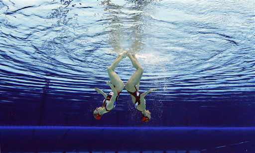 Natalia Ischenko and Svetlana Romanshina of Russia compete during women&#39;s duet synchronized swimming preliminary round at the Aquatics Centre in the Olympic Park during the 2012 Summer Olympics in London, Monday, Aug. 6, 2012. &#40;AP Photo&#47;Mark J. Terrill&#41; <span class=meta>(AP Photo&#47; Mark J. Terrill)</span>