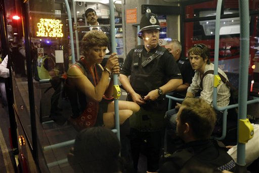Arrested cyclists are loaded on to a bus after a protest outside the Olympic Park during the 2012 Summer Olympics Opening Ceremony, Friday, July 27, 2012, in London.   <span class=meta>(AP Photo&#47; Matt Rourke)</span>