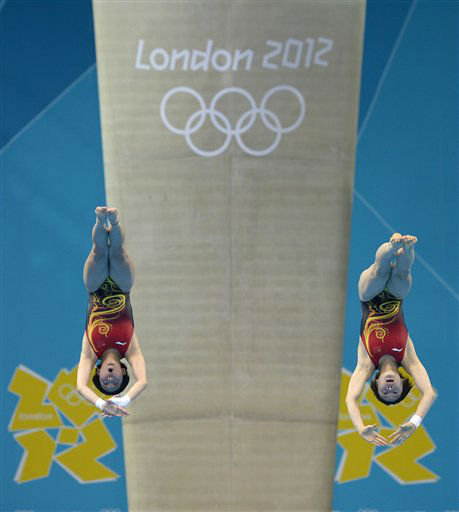 Chen Ruolin and Wang Hao of China compete during the women&#39;s synchronized 10-meter platform diving final at the Aquatics Centre in the Olympic Park during the 2012 Summer Olympics in London, Tuesday, July 31, 2012. China won the gold medal in the event. &#40;AP Photo&#47;Mark J. Terrill&#41; <span class=meta>(AP Photo&#47; Mark J. Terrill)</span>