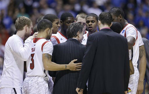 Louisville head coach Rick Pitino huddles with his team after Kevin Ware was taken out of the game following an injury during the first half of the Midwest Regional final against Duke in the NCAA college basketball tournament, Sunday, March 31, 2013, in Indianapolis.  <span class=meta>(AP Photo&#47; Darron Cummings)</span>