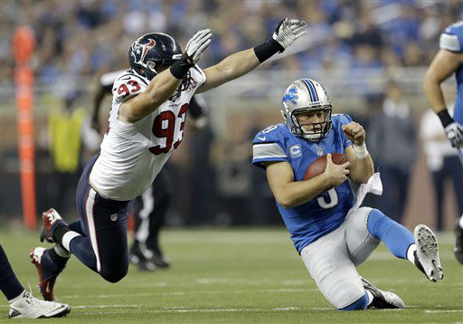 Detroit Lions quarterback Matthew Stafford &#40;9&#41; slides after scrambling away from Houston Texans defensive end Jared Crick &#40;93&#41; during the fourth quarter of an NFL football game at Ford Field in Detroit, Thursday, Nov. 22, 2012.  <span class=meta>(AP Photo&#47; Paul Sancya)</span>