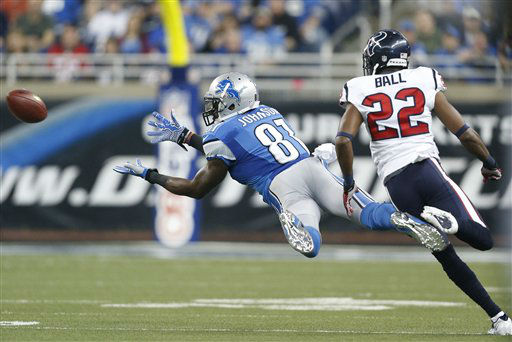 Detroit Lions wide receiver Calvin Johnson &#40;81&#41; makes a diving catch as Houston Texans defensive back Alan Ball &#40;22&#41; defends during the first quarter of an NFL football game at Ford Field in Detroit, Thursday, Nov. 22, 2012. &#40;AP Photo&#47;Rick Osentoski&#41; <span class=meta>(AP Photo&#47; Rick Osentoski)</span>