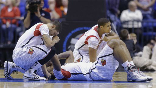 Louisville&#39;s Peyton Siva, left, Chane Behanan, center, and Wayne Blackshear &#40;20&#41; react to LKevin Ware&#39;s injury during the first half of the Midwest Regional final in the NCAA college basketball tournament, Sunday, March 31, 2013, in Indianapolis.  <span class=meta>(AP Photo&#47; Michael Conroy)</span>
