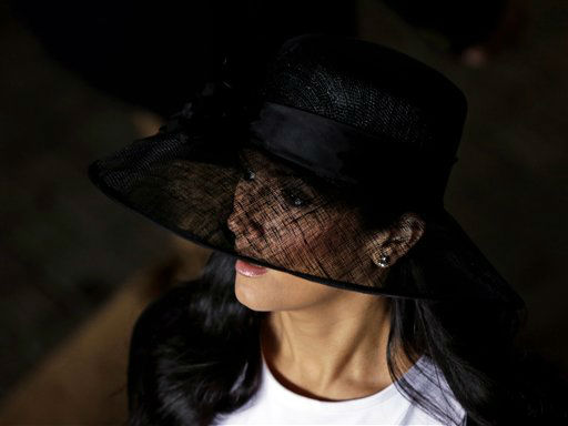 A spectator arrives with her fancy hat to attend the 139th Kentucky Derby at Churchill Downs Saturday, May 4, 2013, in Louisville, Ky.  <span class=meta>(AP Photo&#47; Matt Slocum)</span>