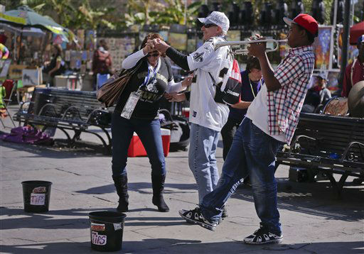 Ann Strain and her husband Sim Strain, of New Orleans, dance to the music of a jazz band at Jackson Square in the French Quarter, Saturday, Feb. 2, 2013, in New Orleans. The city will host NFL football&#39;s Super Bowl XLVII between the Baltimore Ravens and the San Francisco 49ers on Sunday. &#40;AP Photo&#47;Julie Jacobson&#41; <span class=meta>(AP Photo&#47; Julie Jacobson)</span>