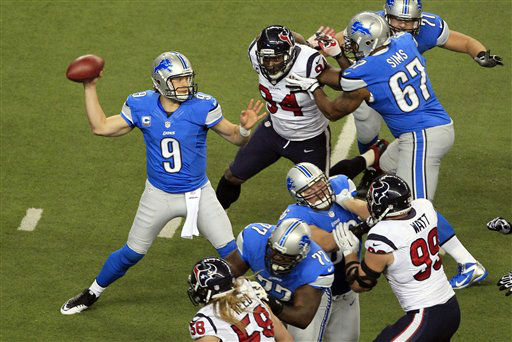 Detroit Lions quarterback Matthew Stafford &#40;9&#41; throws a pass during the first quarter of an NFL football game against the Houston Texans at Ford Field in Detroit, Thursday, Nov. 22, 2012. &#40;AP Photo&#47;Carlos Osorio&#41; <span class=meta>(AP Photo&#47; Carlos Osorio)</span>