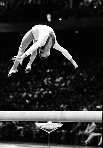 "<div class=""meta ""><span class=""caption-text "">Soviet gymnast Olga Korbut does a backward somersault on the balance beam during an exhibition in Philadelphia, Pa., Monday night, March 19, 1973.  Korbut and the Russian women's gymnastics team are touring the United States.  (AP Photo) (AP Photo/ XNBG)</span></div>"