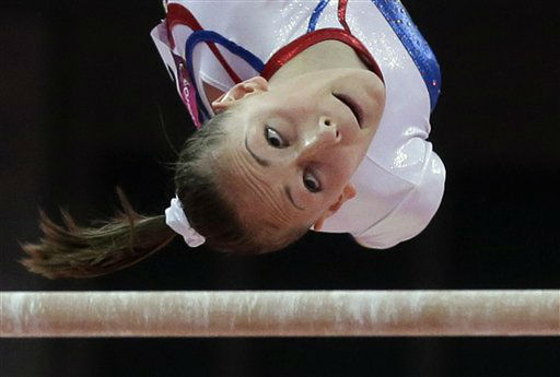 Romania&#39;s gymnast Diana Maria Chelaru eyes the bar during her performance on the uneven bars at Artistic Gymnastics women&#39;s team final at the 2012 Summer Olympics, Tuesday, July 31, 2012, in London. &#40;AP Photo&#47;Julie Jacobson&#41; <span class=meta>(AP Photo&#47; Julie Jacobson)</span>