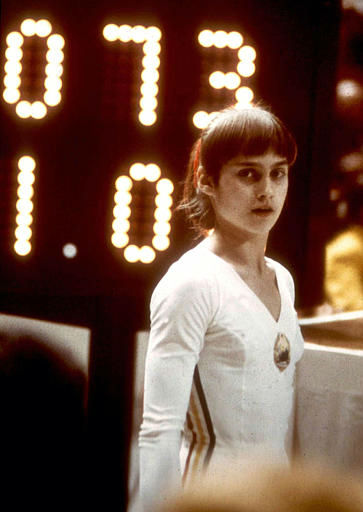 "<div class=""meta image-caption""><div class=""origin-logo origin-image ""><span></span></div><span class=""caption-text"">Romanian gymnast Nadia Comaneci stands before a scoreboard in Montreal, Canada, July 18, 1976. The young gymnast racked up three perfect scores of 10 during the Olympic Games in Montreal. It is the first time in the history of the Olympic games that anyone received a perfect score. (AP Photo) (AP Photo/ XSS HMB)</span></div>"
