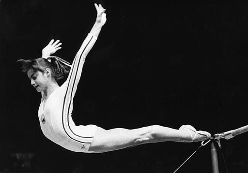 "<div class=""meta ""><span class=""caption-text "">Young Romanian star gymnast Nadia Comaneci jumps off the uneven bars to finish her performance in the individual apparatus finals on July 19, 1976 at the Olympic Games in Montreal. She made sports history with an unprecedented perfect score. (AP Photo/STF) (AP Photo/ XGM)</span></div>"