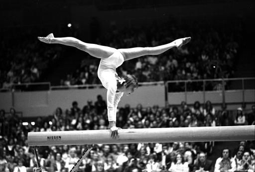 Olga Korbut of the Soviet Union supports herself above the balance beam during her performance in the women&#39;s overall gymnastic program at the Montreal Olympics, July 21, 1976.  Korbut scored 9.5 for her routine.  &#40;AP Photo&#41; <span class=meta>(AP Photo&#47; XSS)</span>