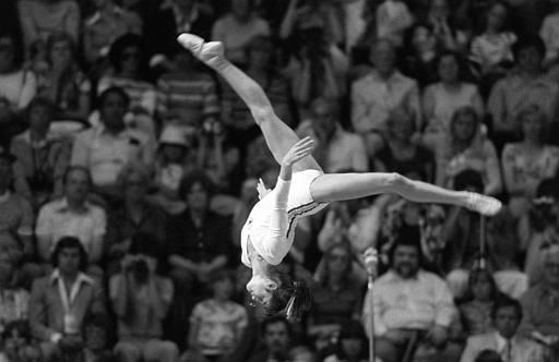 Romanian gymnast Nadia Comaneci, 14, performs a flip on the balance beam en route to a gold medal in the event during the Olympic Games in Montreal, Quebec, Canada on July 22, 1976.  &#40;AP Photo&#47;Stephanie Maze&#41; <span class=meta>(AP Photo&#47; STEPHANIE MAZE)</span>