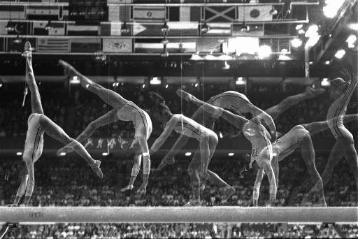 Romania&#39;s Nadia Comaneci, 14, performs her part of the balance beam routine Thursday July 23, 1976 in Olympic competition in Montreal.  This multiple exposure study points out the grace of her movements, leading to a gold medal and a perfect score in the event.  &#40;AP Photo&#47;Suzanne Vlamis&#41; <span class=meta>(AP Photo&#47; SUZANNE VLAMIS)</span>