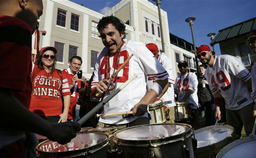 Members of the Niner Noise drum line perform on the street for football fans in the French Quarter, Saturday, Feb. 2, 2013, in New Orleans. The city will host NFL football&#39;s Super Bowl XLVII between the Baltimore Ravens and the San Francisco 49ers on Sunday. &#40;AP Photo&#47;Elaine Thompson&#41; <span class=meta>(AP Photo&#47; Elaine Thompson)</span>