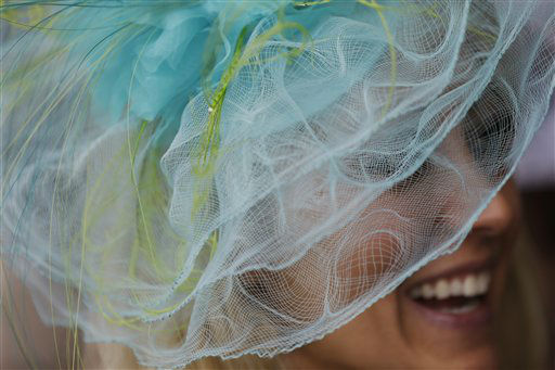 Dana Settles wears a fancy hat during the 139th Kentucky Derby at Churchill Downs Saturday, May 4, 2013, in Louisville, Ky.  <span class=meta>(AP Photo&#47; David Goldman)</span>