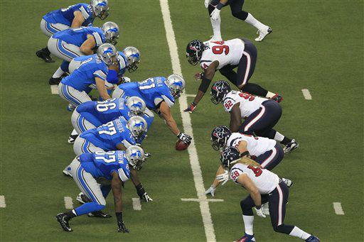 The Detroit Lions and the Houston Texans face off during the first quarter of an NFL football game at Ford Field in Detroit, Thursday, Nov. 22, 2012. &#40;AP Photo&#47;Carlos Osorio&#41; <span class=meta>(AP Photo&#47; Carlos Osorio)</span>