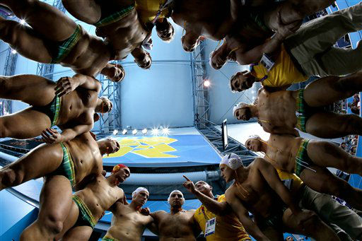 In this photo taken with a fisheye lens, Australia coach John Fox, pointing finger at bottom center right, talks to his players before a men&#39;s quarterfinal water polo match against Serbia at the 2012 Summer Olympics, Wednesday, Aug. 8, 2012, in London. &#40;AP Photo&#47;Julio Cortez&#41; <span class=meta>(AP Photo&#47; Julio Cortez)</span>