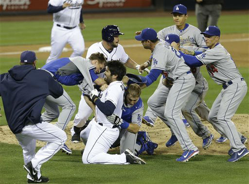 San Diego Padres&#39; Carlos Quentin and teammates battle the Los Angeles Dodgers after Quentin was hit by a pitch thrown by Dodgers pitcher Zack Greinke in the sixth inning of baseball game in San Diego, Thursday, April 11, 2013.  <span class=meta>(AP Photo&#47; Lenny Ignelzi)</span>