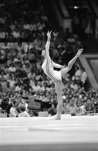 Romania?s Nadia Comaneci does a stunning arabesque during floor exercise in the women?s all-around gymnastics competition finals at the Moscow Olympics on July 24, 1980. But the golden girl of the 1976 Montreal Olympics was outscored by Soviet Yelena Davydova and tied for the silver medal in the event with East Germany?s Maxi Gnauck. &#40;AP Photo&#41; <span class=meta>(AP Photo&#47; Anonymous)</span>
