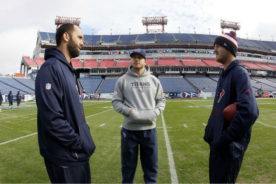 Houston Texans quarterback Matt Schaub, left, and quarterback T. J. Yates, right, talk with Tennessee Titans wide receiver Kevin Walter, center, before an NFL football game Sunday, Dec. 29, 2013, in Nashville, Tenn. &#40;AP Photo&#47;Wade Payne&#41; <span class=meta>(Photo&#47;Wade Payne)</span>