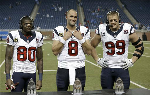 "<div class=""meta ""><span class=""caption-text "">Houston Texans wide receiver Andre Johnson (80), Houston Texans quarterback Matt Schaub (8) and Houston Texans defensive end J.J. Watt (99) receive All-Iron trophies from CBS announcer Phil Simms after an NFL football game against the Detroit Lions in Detroit, Thursday, Nov. 22, 2012. Houston won 34-31 in overtime.  (AP Photo/ Paul Sancya)</span></div>"