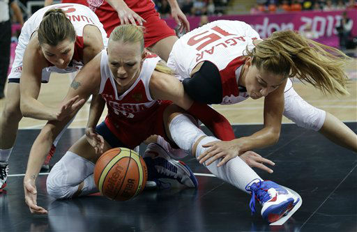 Turkey&#39;s Esmeral Tuncluer, left, and Bahar Caglar, right, scramble for control of the ball with Russia&#39;s Irina Osipova, center, during a quarterfinal women&#39;s basketball game at the 2012 Summer Olympics, Tuesday, Aug. 7, 2012, in London. &#40;AP Photo&#47;Eric Gay&#41; <span class=meta>(AP Photo&#47; Eric Gay)</span>