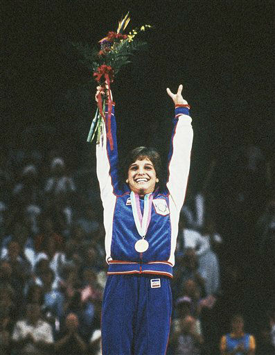 Mary Lou Retton raises her arms after receiving the gold medal in the Women&#39;s Individual All Around Gymnastics final at the Summer Olympic Games in Los Angeles, USA on August 3, 1984 <span class=meta>(AP Photo&#47; Maze)</span>