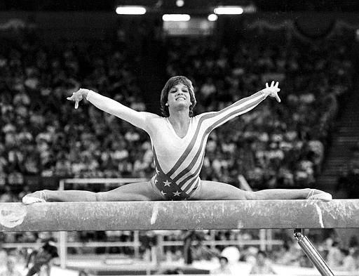 "<div class=""meta ""><span class=""caption-text "">Mary Lou Retton, of the U.S.A., performs on the balance beam during the women's gymnastics individual all-around finals at the XXIII Summer Olympic Games in Los Angeles, Calif., on Aug. 3, 1984.  (AP Photo/Suzanne Vlamis) (AP Photo/ SUZANNE VLAMIS)</span></div>"