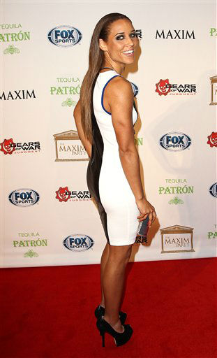 Lolo Jones arrives to The Maxim Party presented by Patron Tequila, on Saturday, Feb. 2, 2013 in New Orleans.